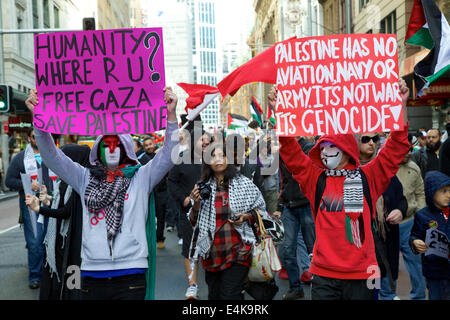 Sydney, NSW, Australia. 13 July 2014. Pro-Palestine protesters hold placards as they march along George Street in - Stock Photo