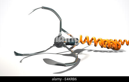 An open metal robotic claw from an arcade type game connected to an orange coiled power cord laying down on an isolated - Stock Photo