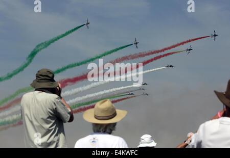 Fairford, United Kingdom. 13th July, 2014. Spectators watch the Italian aerobatic team, Frecce Tricolori, perform - Stock Photo