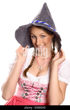 Attractive woman in a traditional German or Bavarian dirndl and rustic party hat - Stock Photo