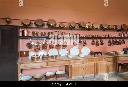 Shiny copper kitchen utensils, pots, pans, saucepans, jugs, white dinner and serving plates, kitchen, Felbrigg Hall, - Stock Photo