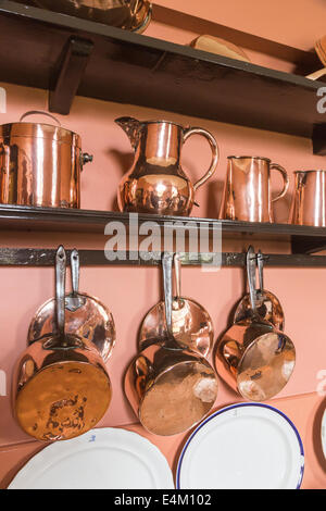 Shiny copper kitchen utensils, jugs, pots and pans displayed in kitchen at Felbrigg Hall, Norfolk, UK - Stock Photo