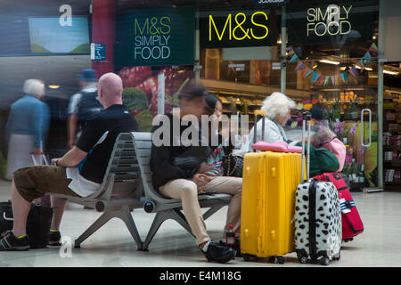 M&S Simply food store at Lime Street, Liverpool, Merseyside, UK. Train Station Busy with Arrivals for Open Golf. - Stock Photo