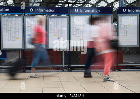 Liverpool Lime Street railway station. Merseyside, UK. Out of focus commuters, at busy Train Station with arrivals - Stock Photo