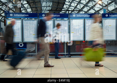 Liverpool Lime Street railway station. Merseyside, UK. Out of focus commuters, crowded train platform a busy Station - Stock Photo
