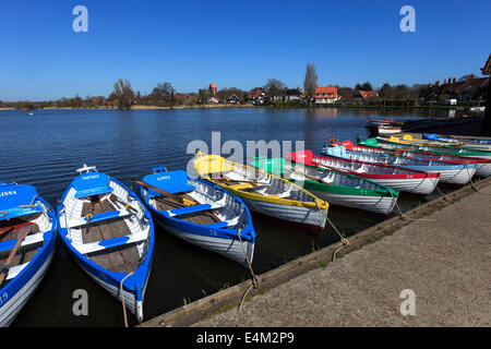 Colourful wooden rowing boats for hire on the Mere at Thorpeness village, Suffolk County, England - Stock Photo