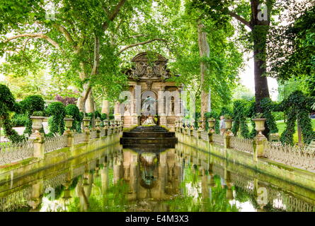 The Medici Fountain is a monumental fountain in the Jardin du Luxembourg in Paris - Stock Photo