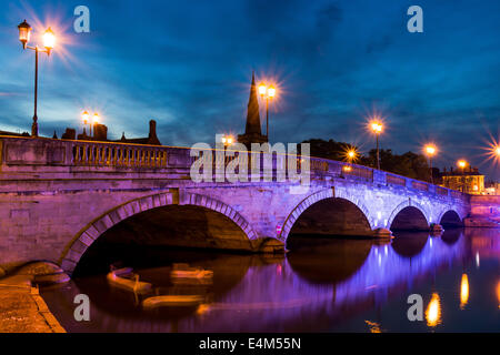 Bedford Bridge and the Great River Ouse as night falls - Stock Photo