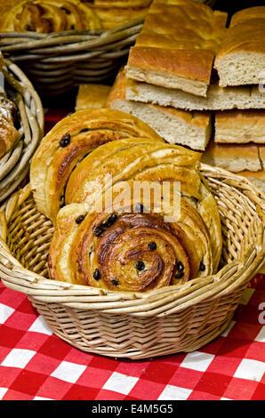 Pain au raisin on an artisan bakers stall in the Grassmarket, Edinburgh, Scotland, UK. - Stock Photo