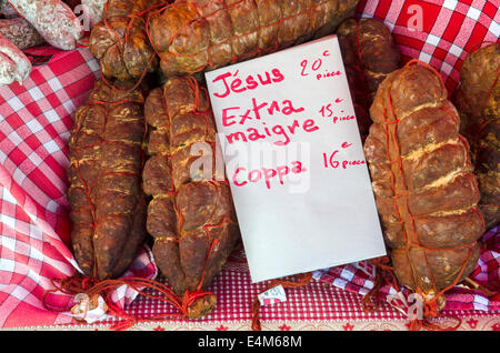 A selection of traditional French sausage on a stall at the Saturday market in Chamonix, Haute Savoie, France. - Stock Photo