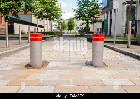 Hydraulically operated high security rising bollards preventing vehicles proceeding down a pedestrian area without - Stock Photo