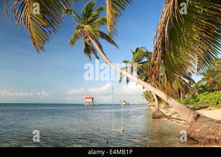 Beach scene in Ambergris Caye, Belize, in the Caribbean Sea - Stock Photo