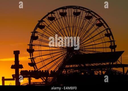 Ferris wheel at sunset, Pacific Park, Santa Monica Pier, Santa Monica, Los Angeles, California, USA - Stock Photo