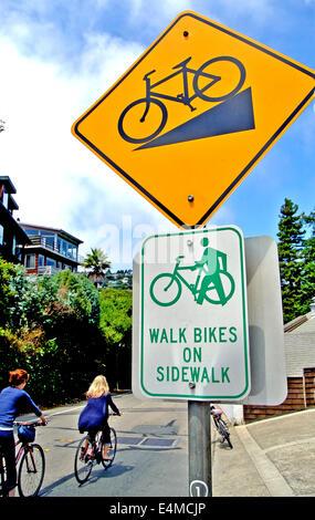 walk bikes on sidewalk sign on sausalito street - Stock Photo