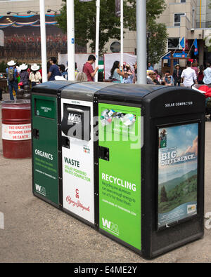 Recycle, waste and organics disposal bins on Calgary Stampede Grounds. - Stock Photo