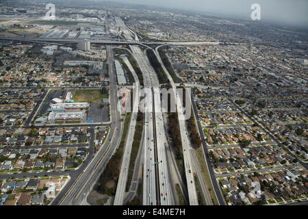 Interstate 405 near LAX, and interchange with I-105 in distance, Hawthorne, Los Angeles, California, USA - aerial - Stock Photo
