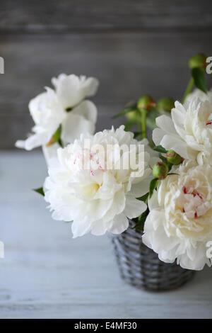 white peonies in a vase, flowers
