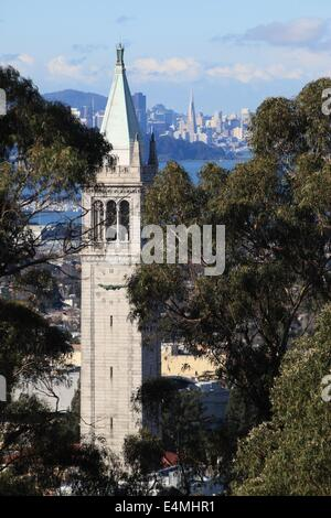 Sather Tower, also known at the Campanile, at the University of California at Berkeley, with San Francisco in the - Stock Photo
