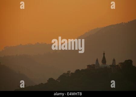 Swayambunath monkey temple in Kathmandu Nepal at sunset - Stock Photo