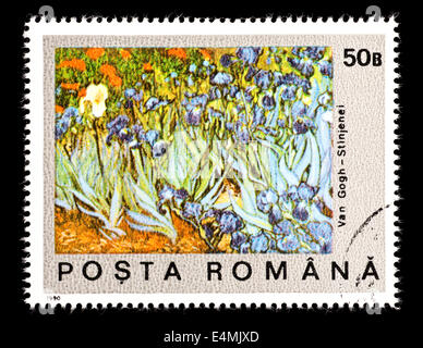 Postage stamp from Romania depicting the Vincent Van Gogh painting of a field of Irises (centennial of death) - Stock Photo