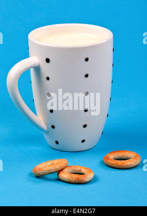 cupful of milk and bread rings - Stock Photo