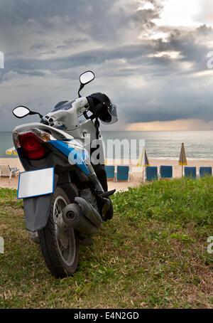 motorcycle on Karon Beach Phuket - Stock Photo