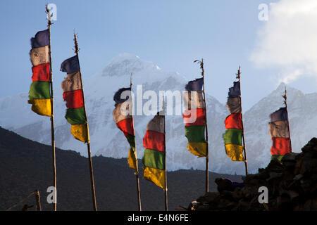Prayer Flags and Nilgiri from Jomsom, Mustang District, Himalayas, Nepal - Stock Photo