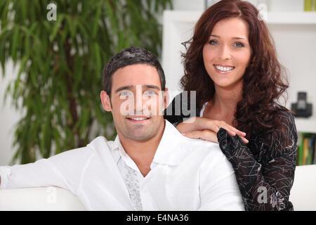Portrait of a couple on their sofa - Stock Photo