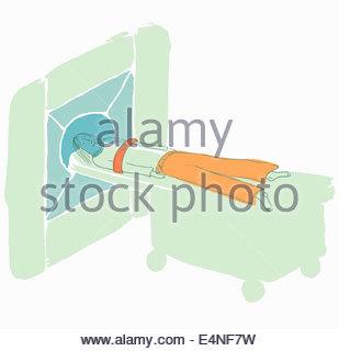 Woman patient having MRI scan - Stock Photo