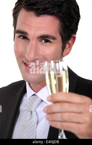 businessman drinking champagne - Stock Photo