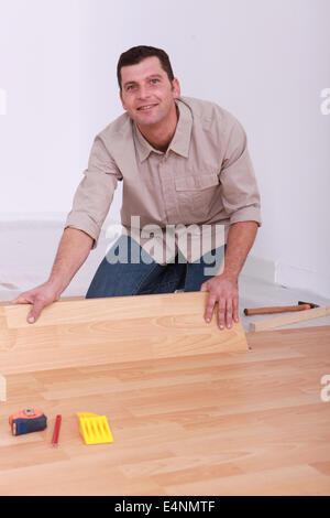 Laminate flooring being installed - Stock Photo