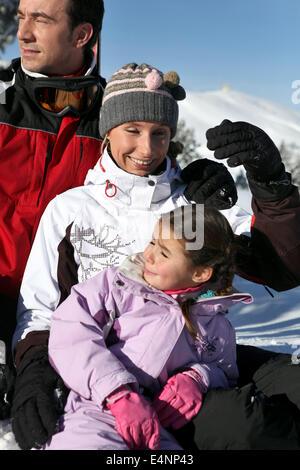 Family enjoying skiing trip - Stock Photo