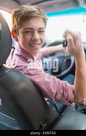 Teenage boy (16-17) driving his first car - Stock Photo