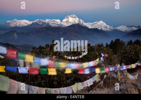 Dhaulagiri and Prayer Flags at Sunrise from Poon Hill, Ghorepani, Nepal - Stock Photo
