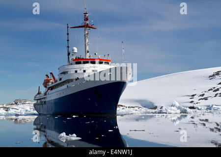 blue with white tourist ship summer day in Antarctic waters - Stock Photo