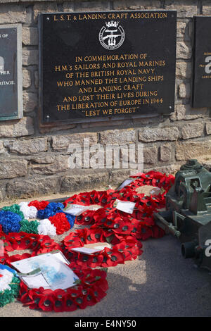 memorial wreaths laid In remembrance outside Musee Du Debarquement D Day Museum in Arromanches, Normandy, France - Stock Photo