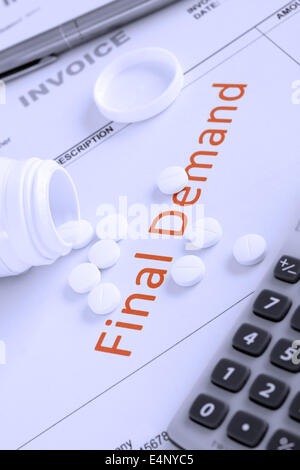 Overdue Invoice with final demand notification in red with scattered pills money worries or stress concept - Stock Photo