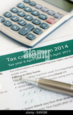 Completing a British working tax credit application form (TC600) concept - Stock Photo