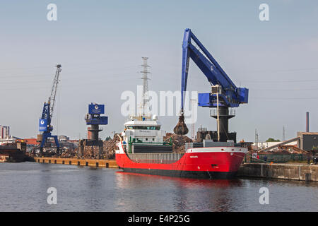 E-Crane, scrap crane loading recycled metal on cargo ship at Van Heyghen Recycling export terminal, port of Ghent, - Stock Photo