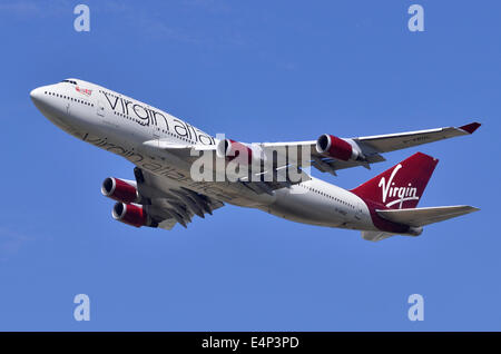 Boeing 747 Jumbo Jet operated by Virgin Atlantic climbing out after take-off from London Heathrow Airport - Stock Photo