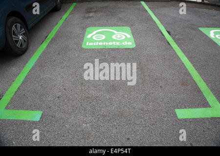 Car charging station in Duisburg, on a parking lot in the city, where electric vehicles can be charged. - Stock Photo