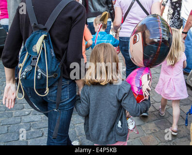 Mother and daughter filled with a gas balloon - Stock Photo