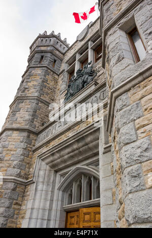 Royal Mint Entrance. The main entrance to the old Royal Mint on Sussex Drive.  A Canadian flag flies above a coat - Stock Photo