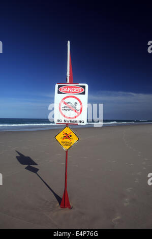 Dangerous currents - no swimming - sign on Main Beach, North Stradbroke Island, Queensland, Australia. No PR Stock Photo