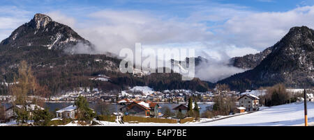 Austrian Mountain Village. Fuschi am See village is clustered around a mountain lake surrounded by high hills - Stock Photo