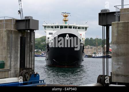 The Caledonian MacBrayne car ferry with bow door open manoeuvring into dock in Oban, Scotland, UK, Europe - Stock Photo