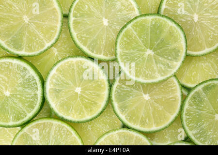 Background made from sliced lime citrus fruits - Stock Photo