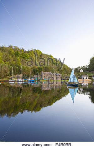 A boy in a small boat at the marina at Bellanoch on the Crinan Canal, Argyll, Scotland. - Stock Photo