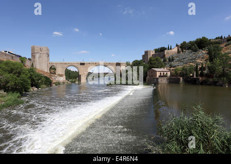 River Tagus and the historic San Martin Bridge in Toledo, Spain - Stock Photo