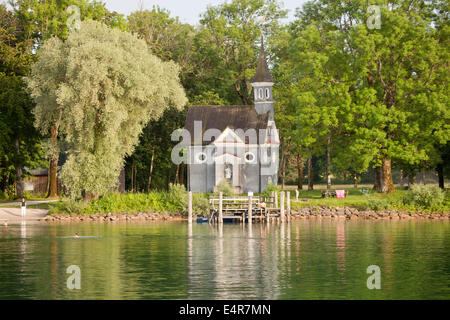 Lakeside Chapel of the Holy Cross on the island Herreninsel in lake Chiemsee, Chiemgau, Bavaria, Germany, Europe - Stock Photo